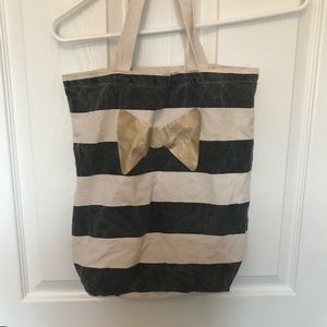 Canvas bag with black stripes and gold bow